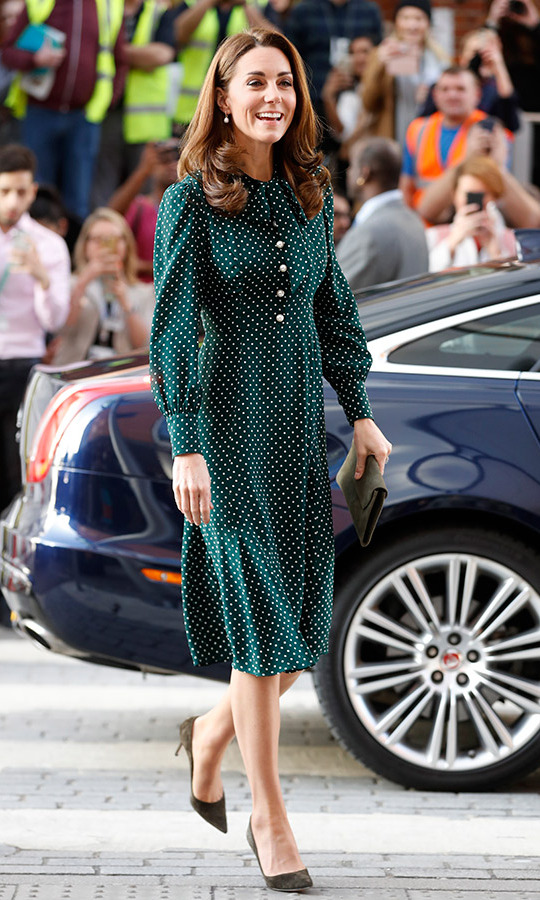 The 36-year-old stunned in a festive L.K.Bennett shirtdress with buttons from the waist up and billowy sleeves. She anchored the look with olive suede pumps and carried a matching clutch. 