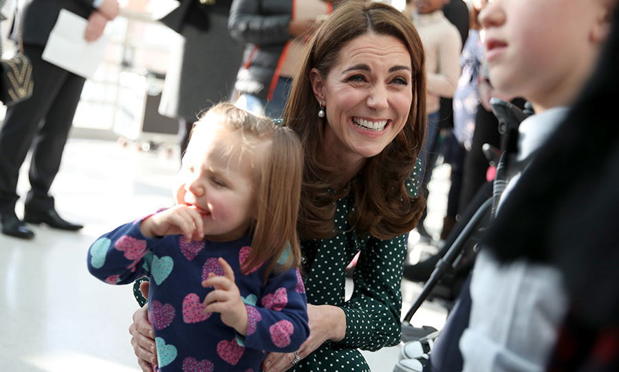 The duchess delighted in a cuddle with this adorable little girl!
