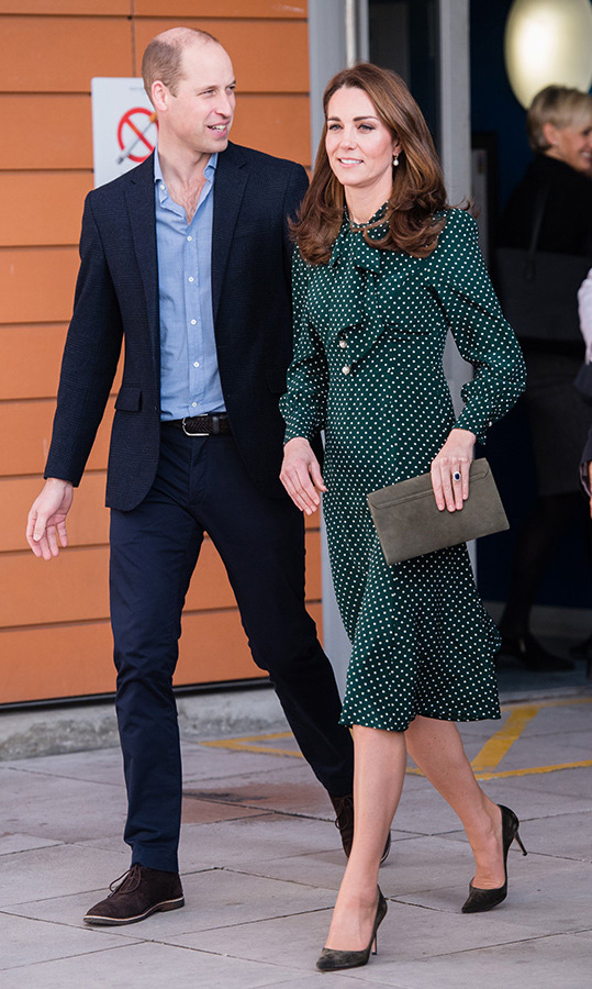 Pretty in polkadots! The Duchess of Cambridge stepped out for a festive day at Evelina London Children's Hospital wearing a green L.K. Bennett dress and carrying a clutch by the same designer. She anchored the look with a pair of green suede heels, and kept her hair in her classic bouncy curls.
