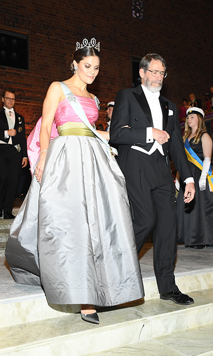 For the Nobel Prize ceremony in Stockholm, Crown Princess Victoria turned many heads as she glided down the marble staircase of the Concert Hall in her mom's vintage Nina Ricci ballgown from 1995. The number features a strapless pink and gold bodice with a full silver skirt and an oversized bow in the back. She paired the colourful number with a sleek updo and topped it off with the 'Forget-Me-Not' Connaught Tiara by E. Wolff & Co.