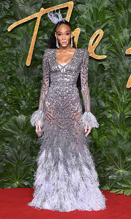 Canadian model Winnie Harlow was decked out head to toe in crystal and feather Atelier Versace for The Fashion Awards in London.