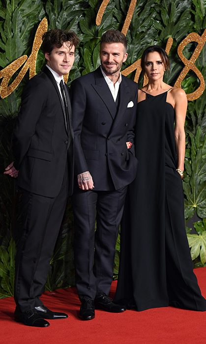 The Beckham brood, minus the youngest three, were out in full force for fashion and dress all in black.