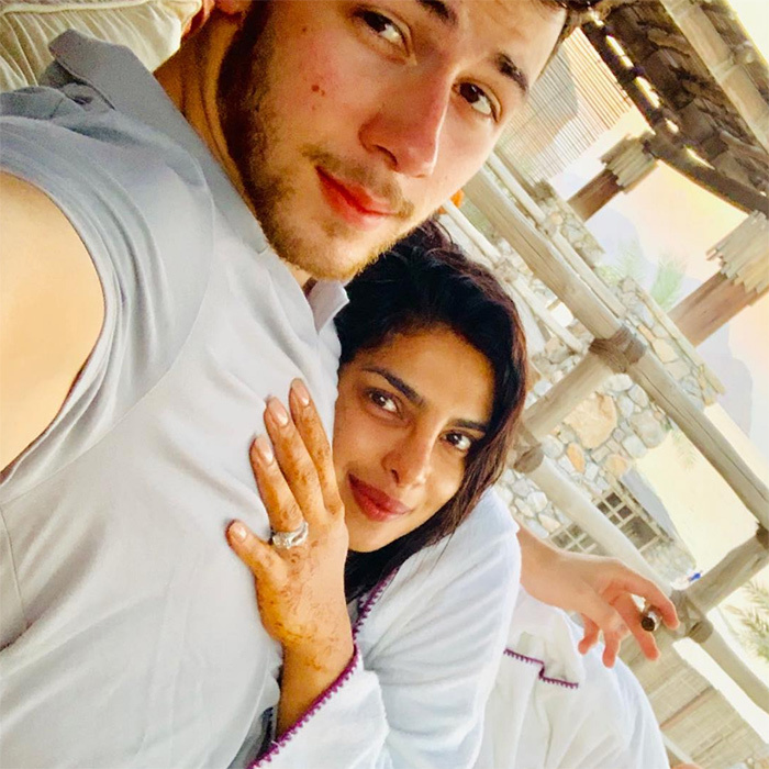 "Nick Jonas and Priyanka Chopra are on cloud nine! The actress shared a sweet photo of her cuddling her husband, writing: ""Marital bliss they say..""