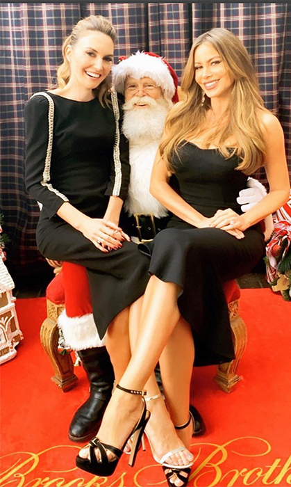 Elizabeth Chambers and Sofia Vergara got to sit on Santa's lap for the sweetest holiday snap, courtesy of Brooks Brothers!