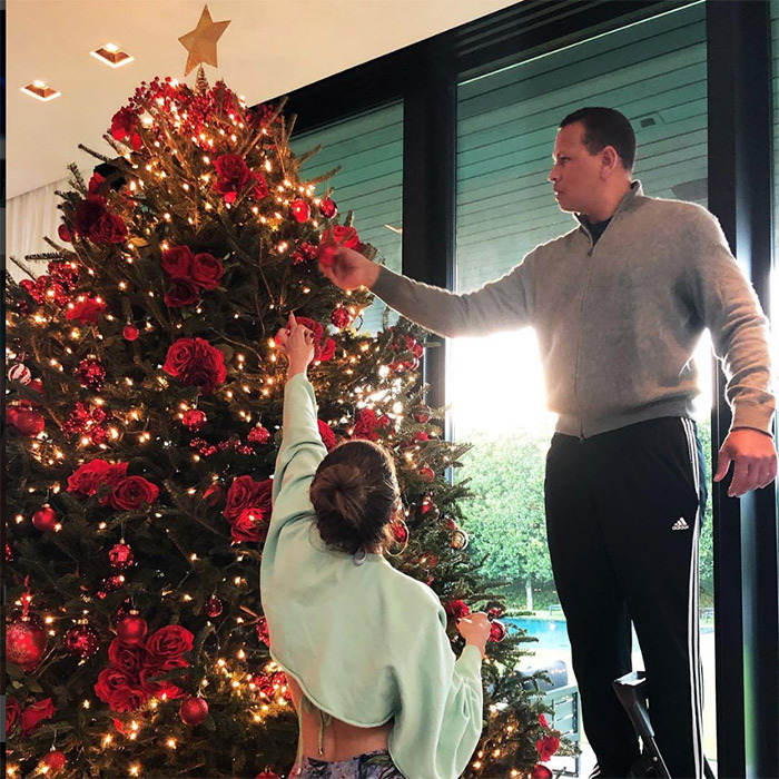 It's getting mighty festive at the Lopez-Rodriguez household! The gorgeous couple put some finishing touches on their huge Christmas tree.
