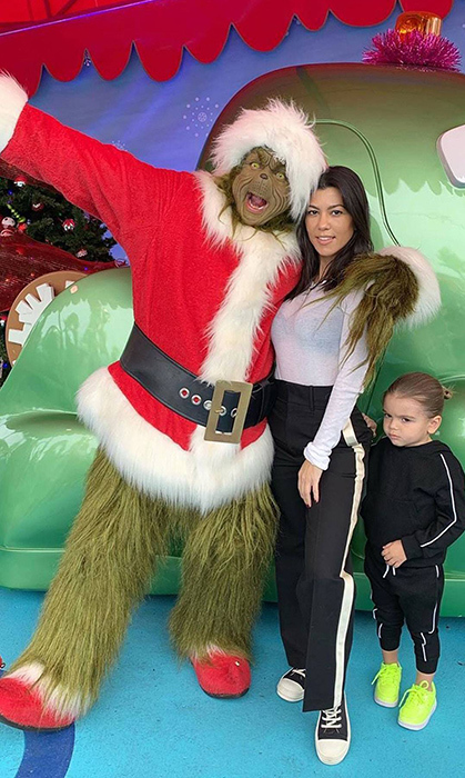 "Kourtney Kardashian and her youngest, Reign Disick, met the Grinch! The reality star captioned the snap: ""He asked the Grinch 'Why did you steal Christmas?'""