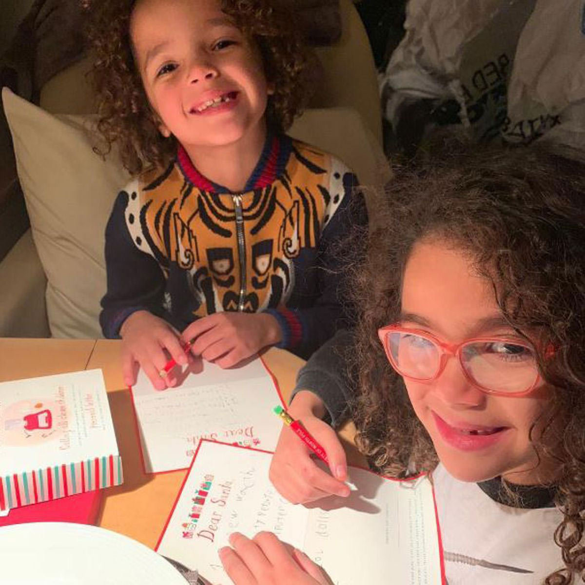 Mariah Carey's adorable twins, Moroccan and Monroe, got busy writing their letters to Santa!