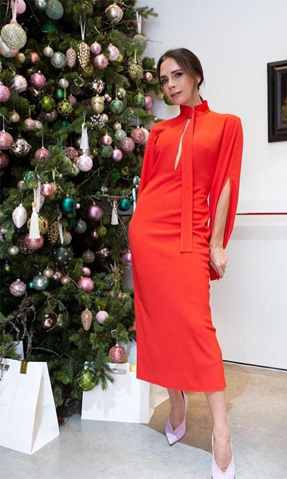 Victoria Beckham got into the holiday spirit in her own way... with fashion, of course! She dazzled in a red dress with beautiful pumps beside her Christmas tree.