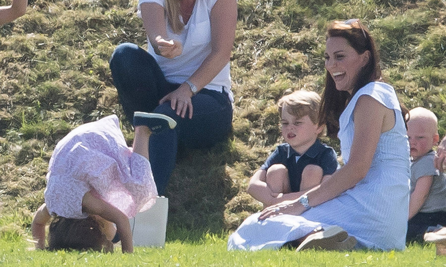Duchess Kate had a giggle as Princess Charlotte showed off her headstand skills at a polo match this summer.