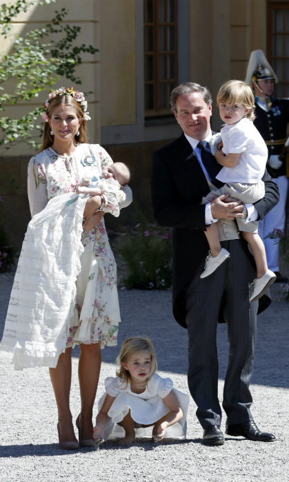 On hand to celebrate Princess Adrienne of Sweden's christening day were her proud siblings, Princess Leonore, four, and Prince Nicolas, two. Sprightly Leonore had trouble sitting still during the service, as the excitement of the day had her twirling in the aisles before taking her shoes off to run around barefoot!