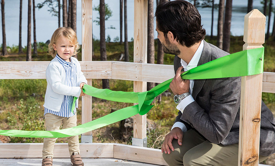 Prince Alexander of Sweden toddled out for his first royal engagement at only two years old! During the ceremonial ribbon ceremony at the Nynas Nature reserve to open the Prince Alexander Viewpoint, the little boy looked very focussed as he gave the green strip a tug! Dad Prince Carl Philip made sure to keep the ribbon steady.