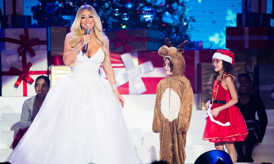 Mariah Carey, dazzling in a white gown, performed with her adorable kids Moroccan and Monroe Cannon during her <em>All I Want For Christmas Is You</em> tour.