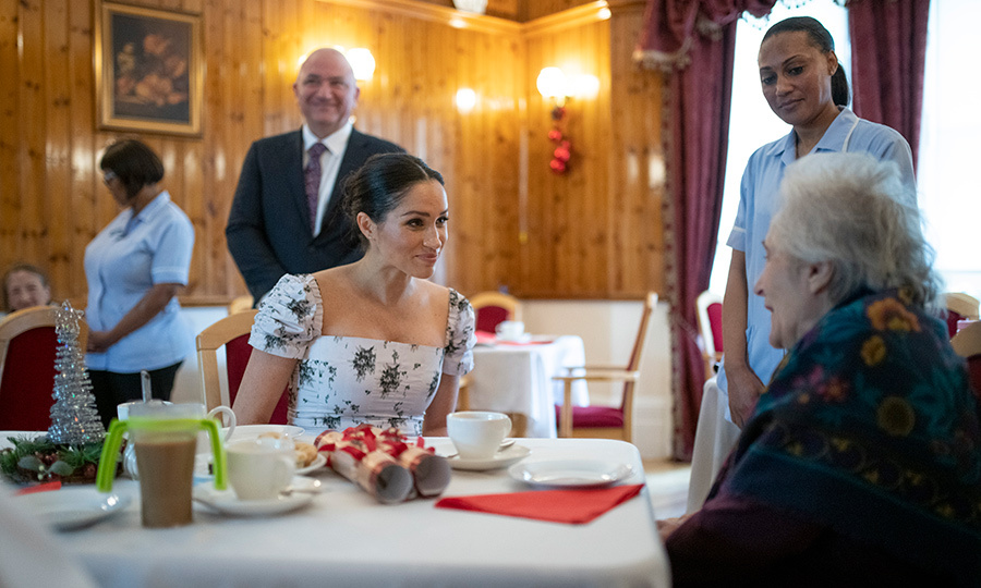 "Ever the charismatic royal, Meghan sat down with one of the home's residents to chat about her career as a performer. The duchess laughed and commented, ""I'm looking very pregnant today.""