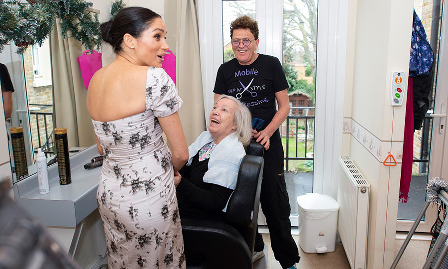 It seems like these two were equally excited to be meeting each other! The pregnant royal stopped by to chat with a woman getting her hair done at the home's salon.