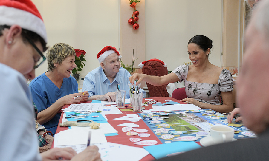 "Meghan helped some of the residents decorate Christmas cards and paper ornaments, using her beautiful calligraphy to write ""Merry Christmas, Love Meghan.""