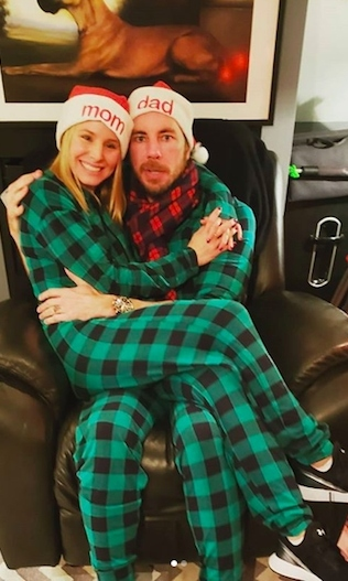 "Kristen Bell and Dax Shepard looked festive in matching onesies, with Christmas caps reading ""mom"" and ""dad""! Kristen wrote on Instagram: ""Merry holidays from your mom and dad!""