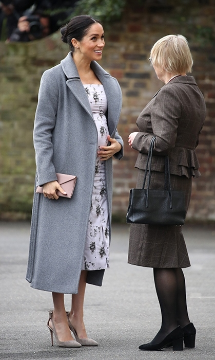 The Duchess of Sussex's baby bump was perfectly in bloom on Dec. 18 as she paid a visit to retired entertainers at Brinsworth House, a nursing home run by the Royal Variety Charity, of which the Queen is patron.