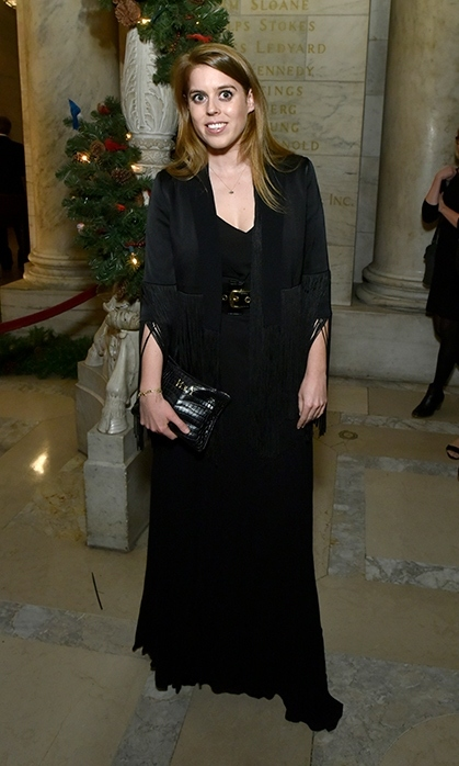 Princess Beatrice and her new boyfriend, property developer Edoardo Mapelli Mozzi, joined a star-studded guest list at New York City's Berggruen Prize Gala on Dec. 10. The 30-year-old's fashion sense was also the talk of the town. Veering away from her go-to silhouettes and penchant for colour, the princess donned an ultra-chic all-black bohemian look. Wearing a black maxi dress, boasting a billowing hem, she defined her waist with a black belt and topped it off with her favourite fringed jacket by Galvan, which she's worn before. Princess Eugenie's gorgeous sister wore her strawberry blond locks blown out by her shoulders and sported a simple, glowing makeup look.