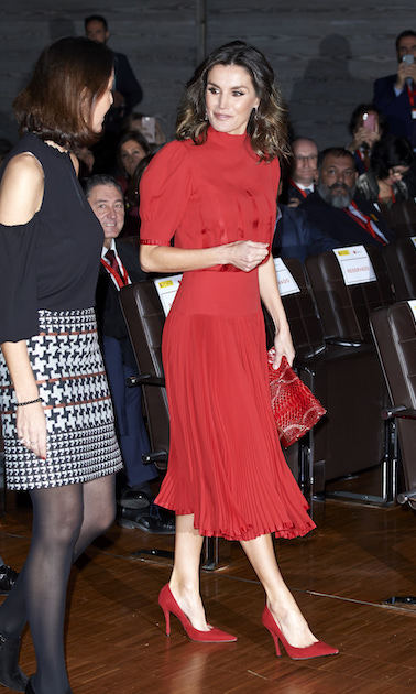 Queen Letizia was radiant in red at the National Fashion Awards at Museo del Traje on Dec. 19. The dress once belonged to Queen Sofia back in 1980. She paired the look with her red Magrit pumps and Carolina Herrera 'Maysa' clutch bag. 