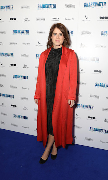 Princess Eugenie dazzled in a black dress and beautiful red coat while attending the charity premiere of <em>Sharkwater Extinction</em> at the Curzon Soho on Dec. 18.
