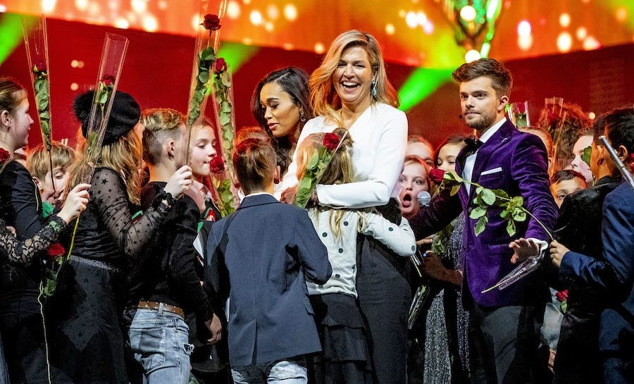 Queen Maxima looked happy as ever to be at the Christmas gala of the biggest schoolband of the Netherlands in the Brabanthallen on Dec. 19. The queen gave a loving hug to one of the kids at the event.
