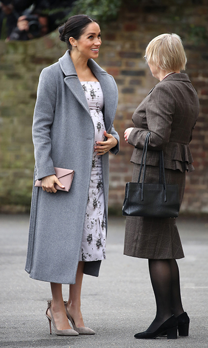 The Duchess of Sussex's baby bump was perfectly in bloom on Dec. 18, 2018 as she paid a visit to retired entertainers at Brinsworth House, a nursing home run by the Royal Variety Charity, of which <strong><a href=/tags/0/queen-elizabeth-ii>the Queen</a></strong> is patron.