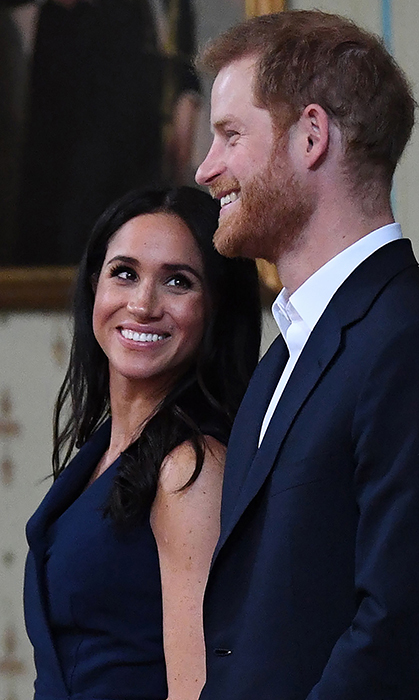 Oh, those sweet looks of love. Meghan had a tender moment watching her husband smile during their royal tour stop in Melbourne.