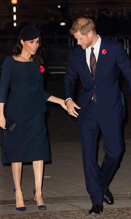 Harry is always looking out for his wife. He helped her step onto uneven ground while arriving at the Westminster Abbey service marking The Centenary Of WW1 Armistice.