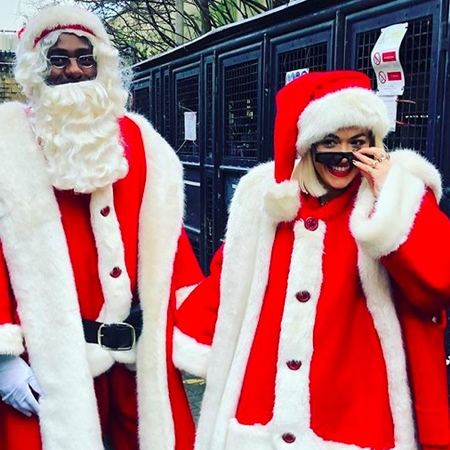 Is that Idris Elba and Rita Ora, or Mr. and Mrs. Clause?! The duo partnered up to bring some Christmas cheer to Chelsea and Westminster Hospital and Evelina Children's Hospital in London.