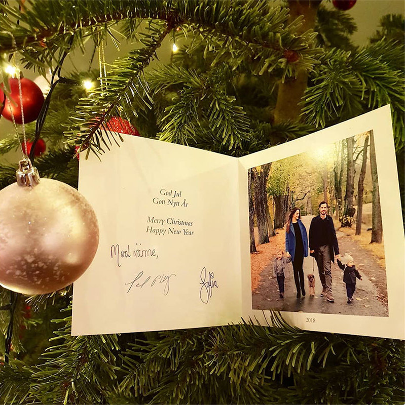 "<a href=""/tags/0/prince-carl-philip/"">Prince Carl Philip</a> and <a href=""/tags/0/princess-sofia/"">Princess Sofia</a> of Sweden shared a sweet, unseen family photo in this year's Christmas card, which they revealed on their official Instagram. It shows the doting parents walking hand-in-hand with their adorable tots and family dog. In true hygge style, the group was captured taking a candid stroll in the woods.