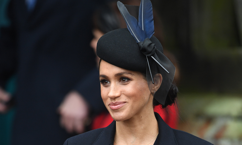 Duchess Meghan dresses her bump in British style at Christmas Day service 5aaf94ea5b58