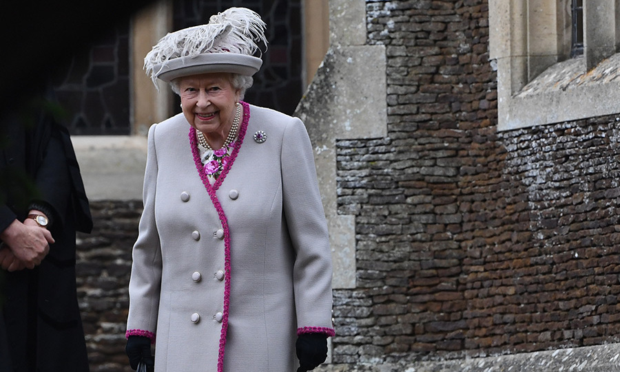 The Queen was all smiles after arriving at the church with her son, the Duke of York. She wore a pretty grey coat with fuchsia piping and a matching grey hat topped with feathers atop a floral dress. 
