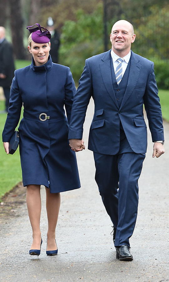 Zara and Mike Tindall were perfectly paired in their blue outfits - she in a belted coat, box clutch and suede pumps with a pretty purple fascinator, he in a three-piece suit with striped tie. 