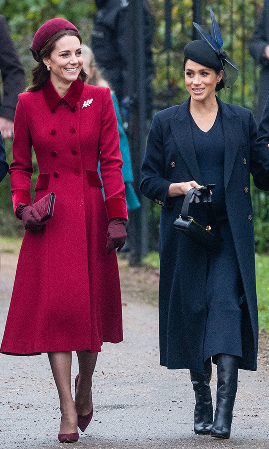 Meghan walked into St Mary Magdalene church in Sandringham alongside her sister-in-law Kate on Dec. 25, 2018 clad in a chic navy ensemble. The mother-to-be paired a simple v-neck dress with Victoria Beckham's sleek coat and leather boots. She topped it off with a black hat festooned with fabric feathers, leather gloves and a small bag and wore her brunette tresses in a tidy side bun. 