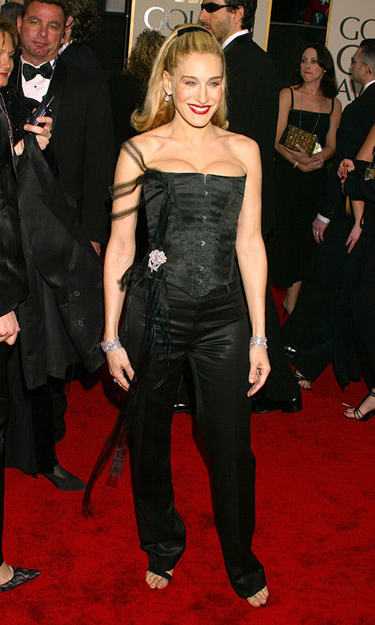 "<em>Sex and the City</em> nominee <a href=""/tags/0/sarah-jessica-parker/"">Sarah Jessica Parker</a> went full Madonna at the 2003 awards show, rocking a high ponytail, black bustier with a glitzy floral hip brooch and satin pants. 