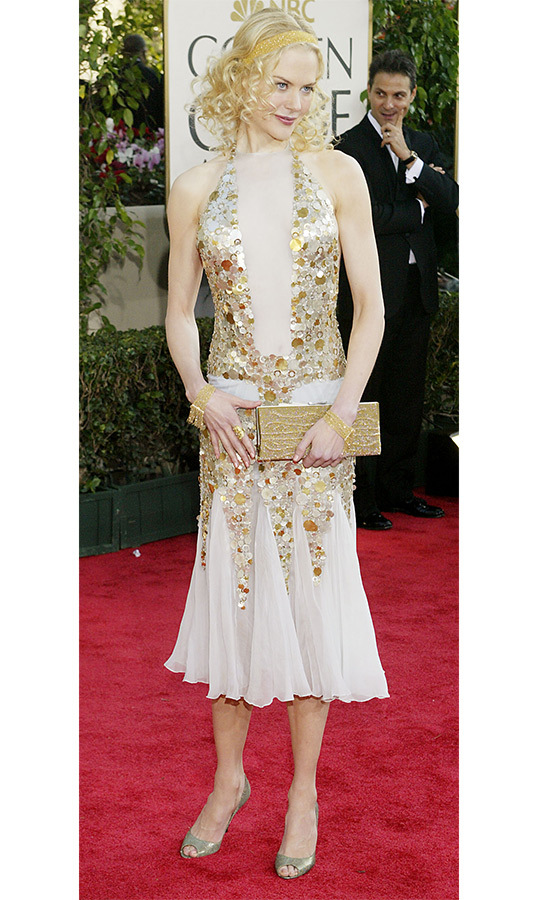 Aussie star Nicole Kidman donned a plunging gold-embellished dress at the 2004 Golden Globes, giving the look an unexpected flapper twist with her face-framing blonde curls and golden headband.