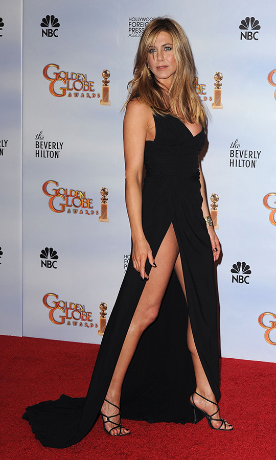 "The 2010 awards saw presenter <a href=""/tags/0/jennifer-aniston/"">Jennifer Aniston</a> rocking one of the highest slits we've ever seen! The former <em>Friends</em> star wore her asymmetrical Valentino gown with strappy Versace sandals.