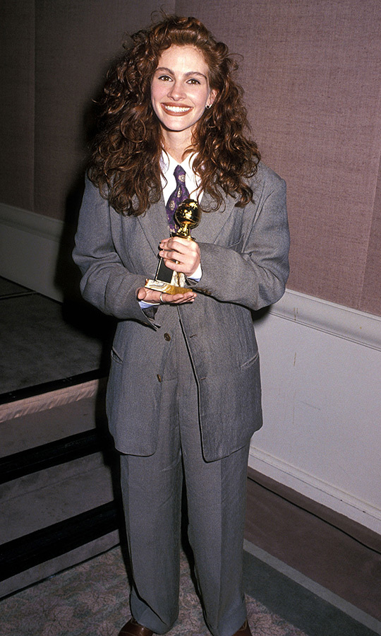 "<a href=""/tags/0/julia-roberts/"">Julia Roberts</a> suited up in grey for the 1990 show, where she took home top honours for her role in <em>Steel Magnolias</em> in an oversized three-piece design with a tie and her signature locks in voluminous curls.