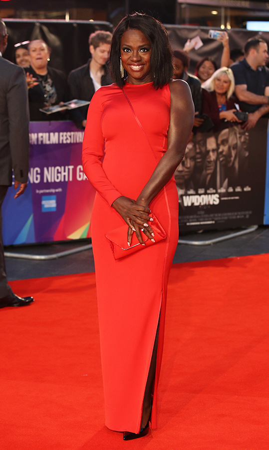 "Count on <a href=""/tags/0/viola-davis/"">Viola Davis</a>, 53, to bring elegance to the red carpet. The actress dazzled in a classic figure-hugging red gown with a twist - asymmetrical sleeves - for the European premiere of <em>Widows</em>.