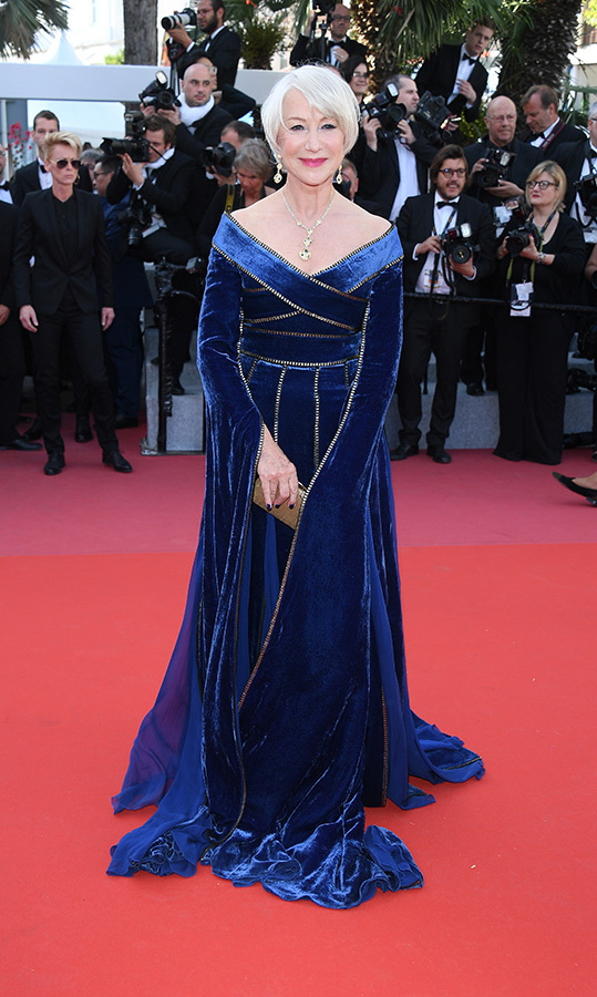 "There's no competition for <a href=""/tags/0/helen-mirren/"">Helen Mirren</a>, 73, who's the queen of regal style on and off the screen. The iconic actress brought her best fashion game to the premiere of <em>Girls Of The Sun</em> in Cannes, clad in a medieval-style, royal blue velvet gown by Elie Saab with gorgeous caped sleeves and the most beautiful off-the-shoulder neckline.