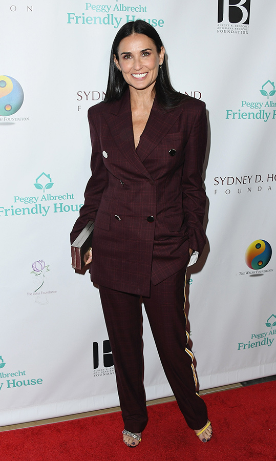 "<a href=""/tags/0/demi-moore/"">Demi Moore</a>, 56, oozed cool in a maroon pantsuit at Peggy Albrecht Friendly House's 29th Annual Awards Luncheon in October. The double-breasted ensemble featured a fashion-forward racing stripe on the pants, which she helped make pop with bright yellow heels.