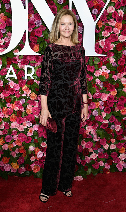 Flower power! For the Tony Awards in June, actress Joan Allen, 62, dazzled in a stunning velvet floral pantsuit with a matching maroon clutch and a pair of black strappy heels.