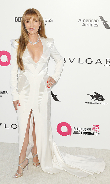 "<a href=""/tags/0/jane-seymour/"">Jane Seymour</a>, 67, made jaws drop in a stunning white gown for the 26th Annual Elton John AIDS Foundation's Academy Awards Viewing Party in West Hollywood! The actress's look featured chic accentuated shoulders and a daring slit up the front. She made sure to sparkle bright with diamond accessories and a gorgeous pair of metallic heels.