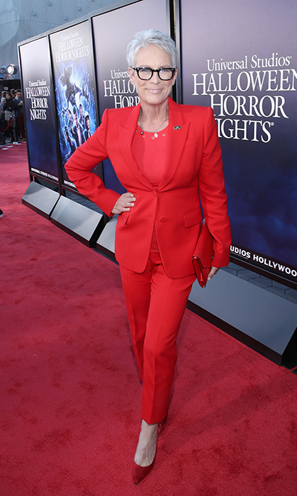 "<a href=""/tags/0/jamie-lee-curtis/"">Jamie Lee Curtis</a>, 60, was radiant in red while attending the Halloween Horror Nights event at Universal Studios Hollywood in September. She anchored the look with a pair of red suede heels and accessorized with a small clutch and her trademark black frames.