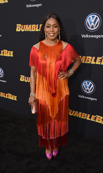 "<a href=""/tags/0/angela-bassett/"">Angela Bassett</a>, 60, brought colour to the <em>Bumblebee</em> red carpet in December! The actress absolutely stunned in a fringed red-and-orange ensemble, paired with hot-pink shoes and smoky eye makeup that had us swooning. The actress accessorized with bracelets from Hearts On Fire and a ring from Csarite by Erica Courtney.
