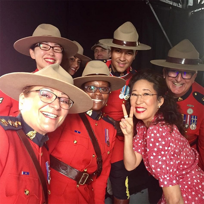 "Nothing screams ""Oh Canada!"" like a quick snap with some Royal Canadian Mounted Police! She wore the perfect dress for Canada Day and threw up a peace sign with some mounties back in 2017.