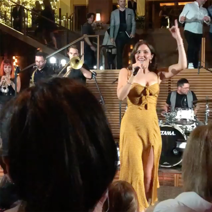 "Katharine's proud mom, Peisha, posted two videos of the singer performing during the hotel's new year festivities, clad in a sexy yellow dress with a thigh-high slit. ""2019 !! Thats how to do it!!"" she captioned one. 