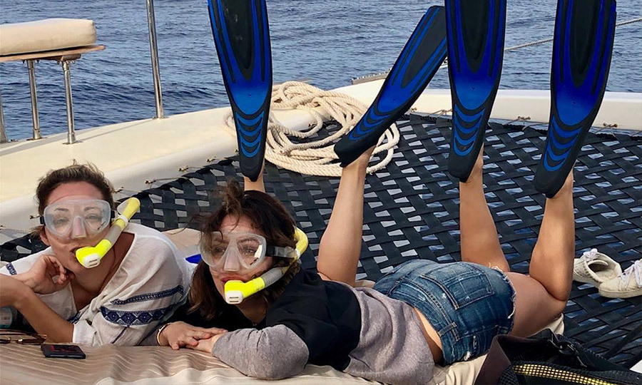 "Peisha caught her two daughters goofing around on a boat. ""My little Mermaids!! Getting ready for our snorkeling trip!"" she said. 