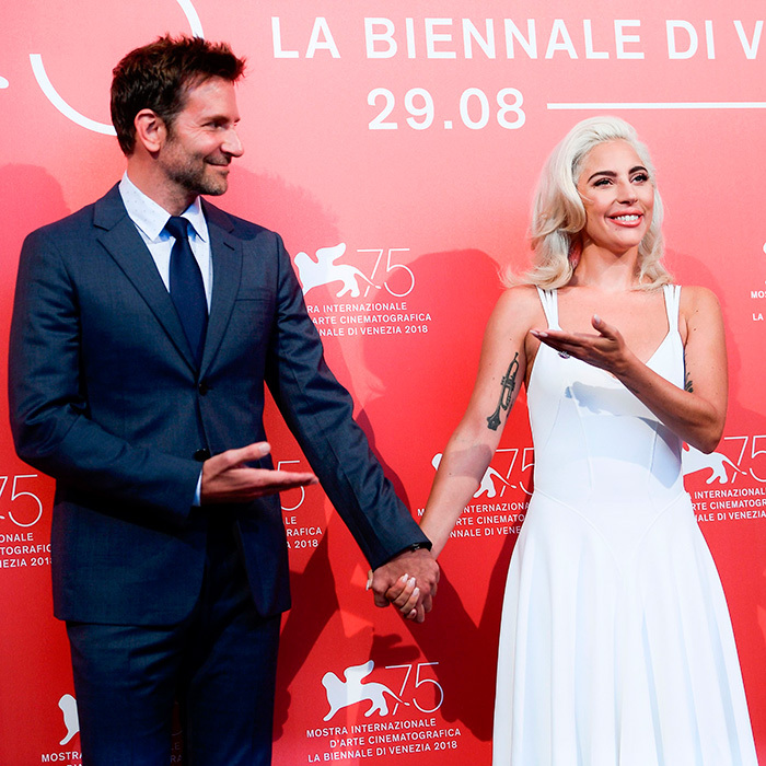 No, <em>you're</em> the best! During a photocall in Venice for <em>A Star Is Born</em>, Lady Gaga and Bradley praised each other's talent, clasping hands for some snaps.