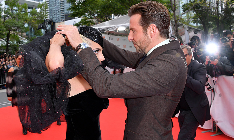 In one of the most heartwarming moments of all their red-carpet appearances, Bradley literally unveiled his star, Lady Gaga, at TIFF. The talented musician stole the show in her black velvet Armani Privé gown with a gauzy veil that turned into a shrug. It was certainly a look – and Kodak moment – fit for a star.